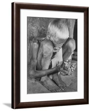 Old Indian Man Holding Handful of Leaves He Will Boil and Eat During Famine Caused by Drought--Framed Photographic Print