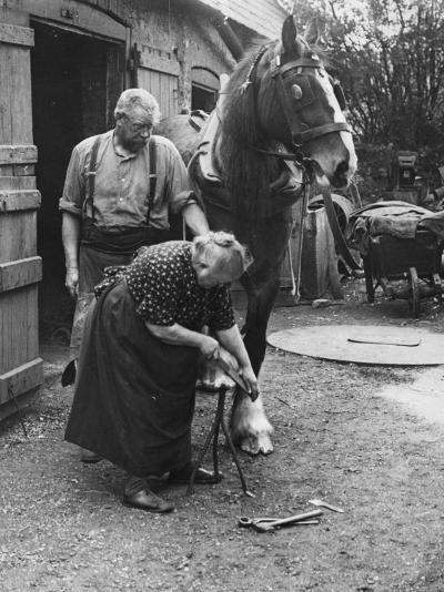 Old Lady Blacksmith--Photographic Print