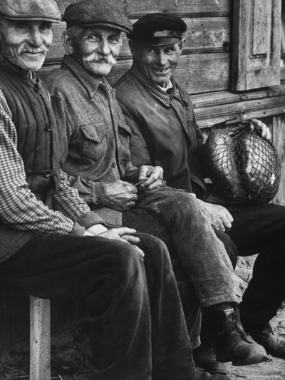 Old Men Smiling, Sitting on Bench, After Waiting in Line For Meat-Paul Schutzer-Photographic Print
