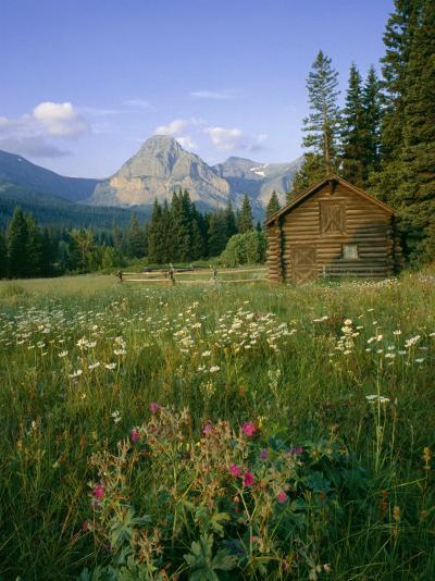 Old Park Service cabin in the Cut Bank Valley of Glacier National Park in Montana-Chuck Haney-Photographic Print