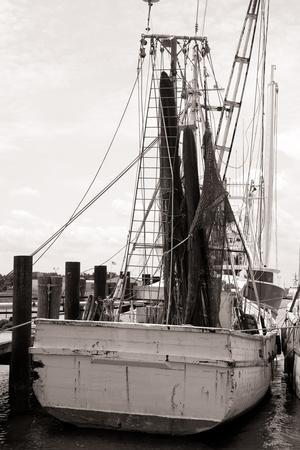 https://imgc.artprintimages.com/img/print/old-shrimp-boat-in-marina_u-l-q103yhh0.jpg?p=0