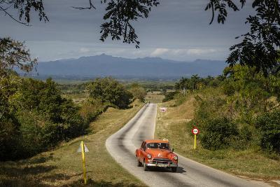 Old Vintage American Car on a Road Outside Trinidad, Sancti Spiritus Province, Cuba-Yadid Levy-Photographic Print