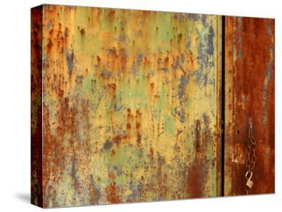 Old Weather Worn Metal Doors Covered in Decaying Rust and Lime