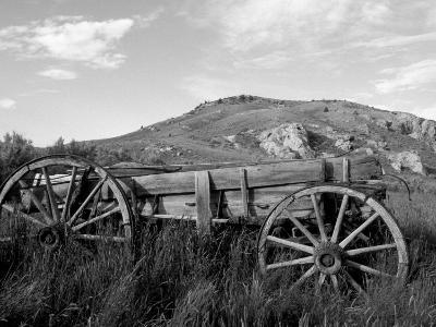 Old Wood Wagon near Mining Ghost Town at Bannack State Park, Montana, USA-John & Lisa Merrill-Photographic Print