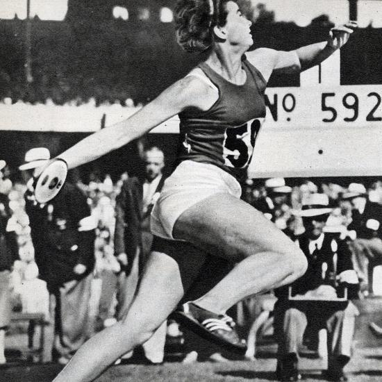 Olga Fikotova of Czechoslovakia Setting a New Olympic Record in the Final of the Women's Discus--Photographic Print