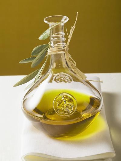Olive Oil in Carafe with Olive Branch--Photographic Print