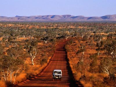 Car on Outback Road, Karijini National Park, Australia
