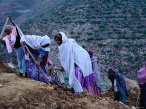 Women Repairing Road on Hillside, Eritrea by Oliver Strewe
