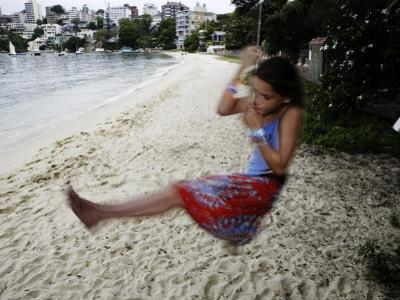 Young Girl Swinging on a Rope, Seven Shillings Beach