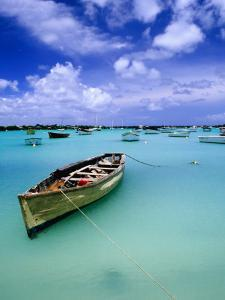 Fishing Boats Anchored in Lagoon by Olivier Cirendini