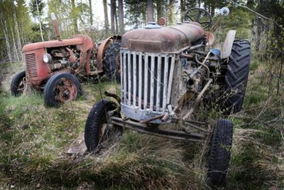 Two Old Rusty Tractor in the Forest by Ollikainen
