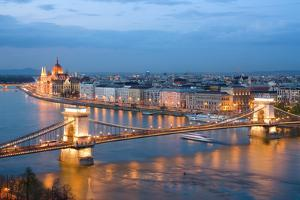 Budapest, Night View of Chain Bridge on the Danube River and the City of Pest by ollirg