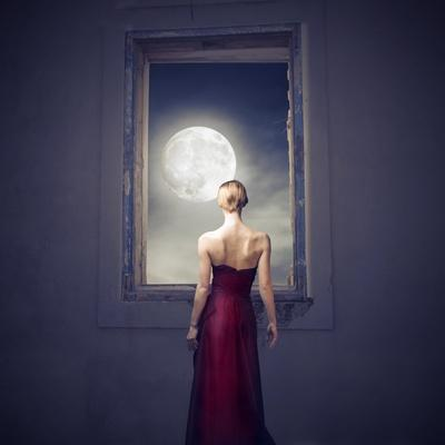 Beautiful Woman Observing the Moon from a Window
