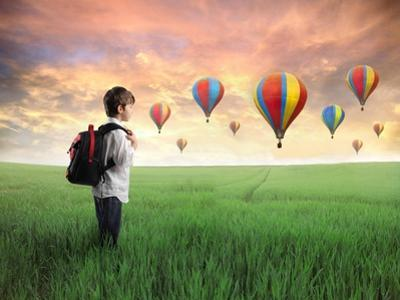 Child Carrying A Backpack Standing On A Green Meadow With Hot-Air Balloons In The Background by olly2