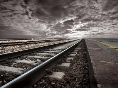 Empty Railway Tracks In A Stormy Landscape by olly2