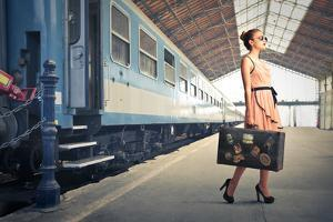 Fair Traveler With Vintage Suitcase At The Station by olly2