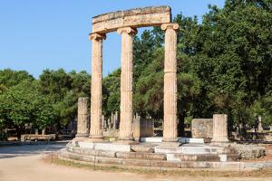 Olympia, Peloponnese, Greece. Ancient Olympia. The Philippeion, 4th century BC. Remains of a cir...