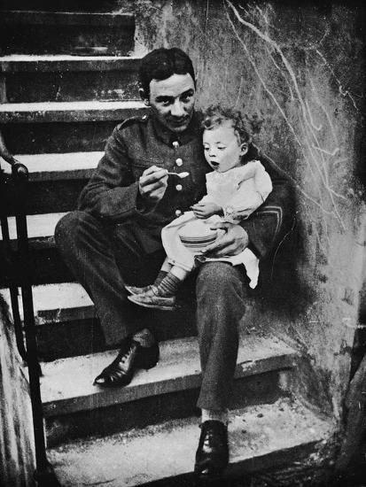 'One of the New Army making himself useful in his billet', 1915-Unknown-Photographic Print