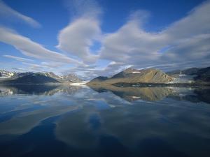Arctic Skyline Reflecting in Water by Onne van der Wal