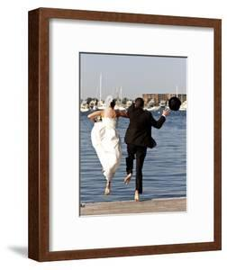 Newlyweds Jumping into Marriage, Newport, Rhode Island, USA, October 2011. Model Released by Onne Van Der Wal