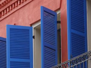 Open Blue Window Shutters on Ornate Building in New Orleans, Louisiana
