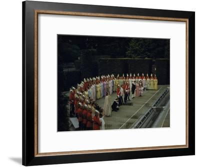 Opera Singers and Chorus Rehearse a Curtain Call on an Outdoor Stage-B. Anthony Stewart-Framed Photographic Print