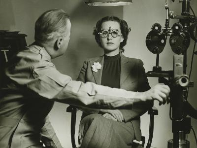 Optician Examining Patient's Eyes-George Marks-Photographic Print