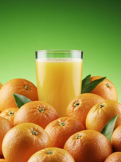 Orange Juice and Fresh Oranges-Miguel G. Saavedra-Photographic Print