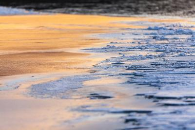 Orange Light from the Sunrise Reflects Off Smooth Ice, Contrasting with the Blue Rough Ice-Jak Wonderly-Photographic Print