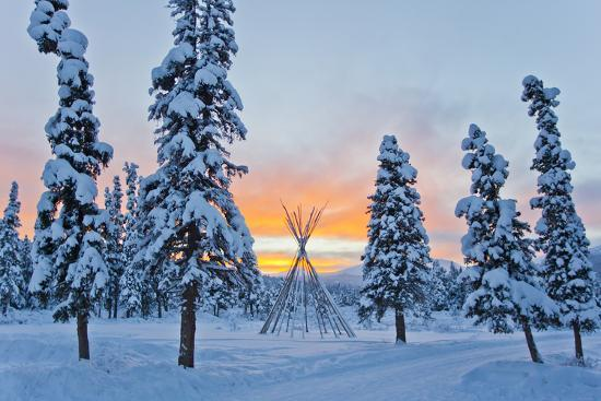 Orange Sky at Sunset Over Snow-covered Evergreens and a Tee Pee Form-Mike Theiss-Photographic Print