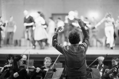 Orchestra Conductor Leading the Musicians in the Theater-Anna Jurkovska-Photographic Print