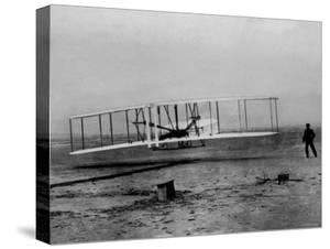 Orville Wright Taking Plane For 1st Motorized Flight as Brother Wilbur Wright Looks at Kitty Hawk