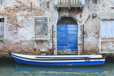 Boat And Blue Door. Venice. Venezia Province. Veneto. Italy