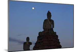 Stone Buddhas With Common Myna (Acridotheres Tristis) On Top And Moon. Thailand by Oscar Dominguez