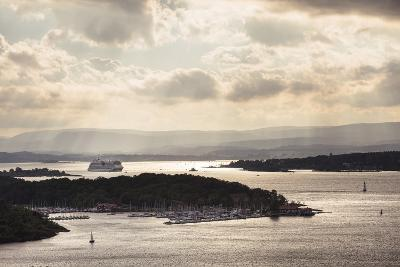 Oslo, Østlandet, Norway: Cruise Ship Aidaluna Entering Oslo Harbor In Late Afternoon-Axel Brunst-Photographic Print