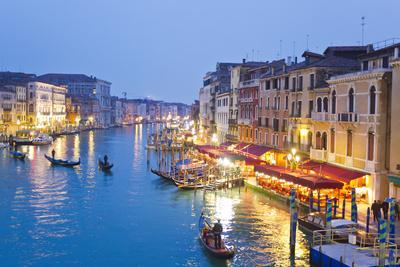 Outdoor Cafes and Gondolas Line Venice's Grand Canal Reflecting City Lights at Dusk-Mike Theiss-Premium Photographic Print