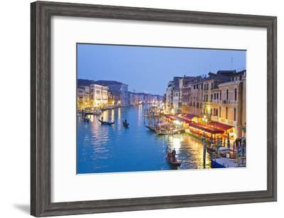 Outdoor Cafes and Gondolas Line Venice's Grand Canal Reflecting City Lights at Dusk-Mike Theiss-Framed Photographic Print