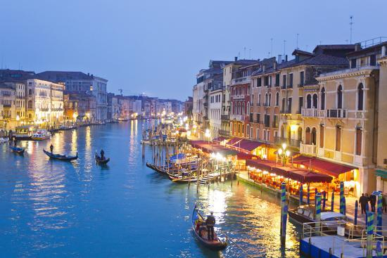 Outdoor Cafes and Gondolas Line Venice's Grand Canal Reflecting City Lights at Dusk-Mike Theiss-Photographic Print