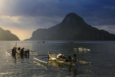 Outrigger Boat at Sunset in the Bay of El Nido, Bacuit Archipelago, Palawan, Philippines-Michael Runkel-Photographic Print