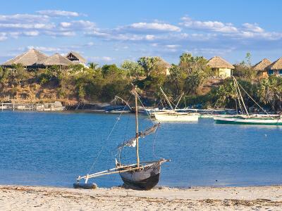 Outrigger Boat Lying on Bank of Sand, Antsanitian Beach Resort, Mahajanga, Madagascar-Michael Runkel-Photographic Print