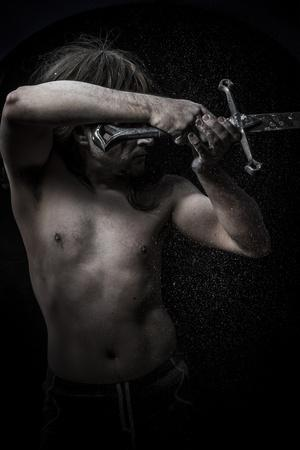Naked Warrior Carrying Steel Sword