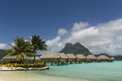 Over-The-Water Bungalows at a Tropical Resort with Clear Turquoise Water-Sergio Pitamitz-Photographic Print