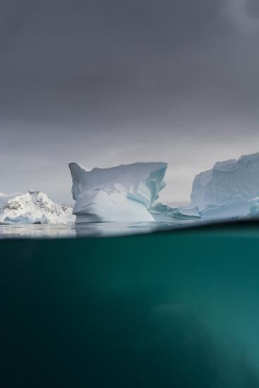 Over-Under View of an Iceberg, Skontorp Cove, Paradise Bay, Antarctica-Sergio Pitamitz-Photographic Print