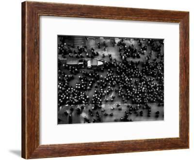Overhead View of Men Relaxing on 36th Street, Between Eighth and Ninth Aves.-Margaret Bourke-White-Framed Premium Photographic Print