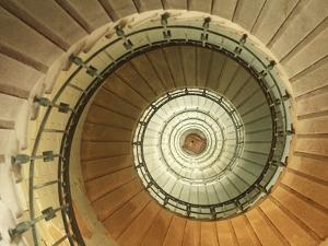 Spiral Staircase at Eckmuhl Lighthouse in Brittany by Owen Franken