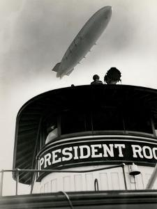 Airship Akron over Ferryboat President Roosevelt by P.L. Sperr