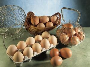 High Angle View of Eggs in Baskets and a Carton by P. Martini
