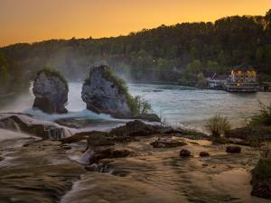 The Rhine Falls with Schlossli Worth, with Schaffhausen, Canton Schaffhausen, Switzerland, Europe by P. Widmann