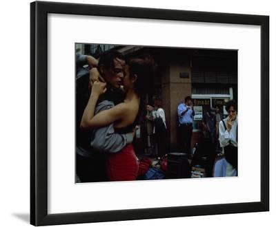 A Passionate Couple Dance the Tango on a South American Street Corner