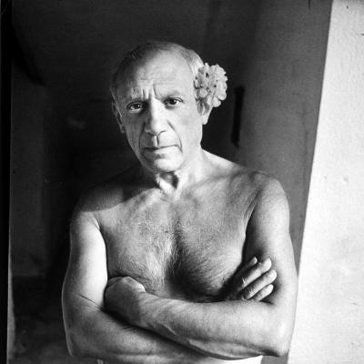 Pablo Picasso, Bare Chested and with Flower Tucked Behind Ear-Gjon Mili-Premium Photographic Print